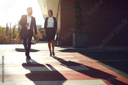 Business People walk along the city street. Canvas Print