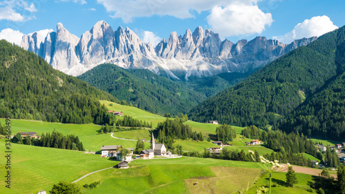 Beautiful dolomite rocks and village on a sunny day in Northern Italy Canvas Print