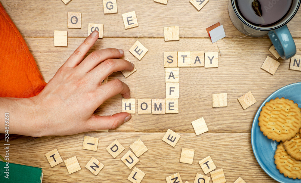 Fototapeta Stay home stay safe concept. Quarantine against coronavirus covid-19 in the world with a call to stay and work at home cozy. Homework and activities for the whole family