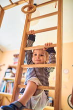 Two Year Old Child Climbs Stai...