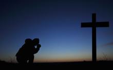 Clasped Hands In Prayer. Cruci...