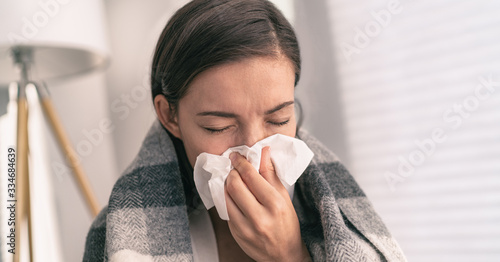 Fototapeta Cough in tissue covering nose and mouth when coughing as COVID-19 hygiene guidelines for coronavirus spread prevention