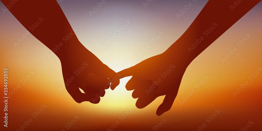 Fototapeta Concept du sentiment amoureux avec un couple qui se donne la main en signe d'union.
