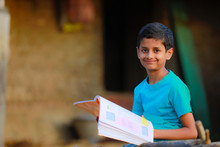 Cute Indian Child Studying At ...