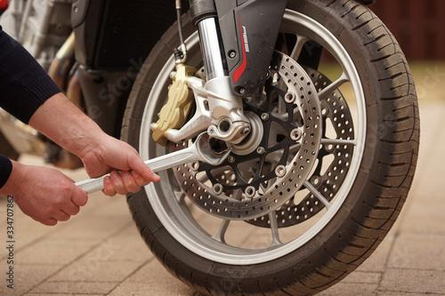 Technician hands repairing motobike, doing repair service, maintenance worker r Canvas Print