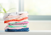 Stack Of Cotton Colorful Clothes,folded Clothing On Table Empty Space.