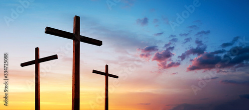 Fototapeta Cross of Jesus Christ empty over dramatic sunrise sky panorama with sclouds.  Easter concept obraz