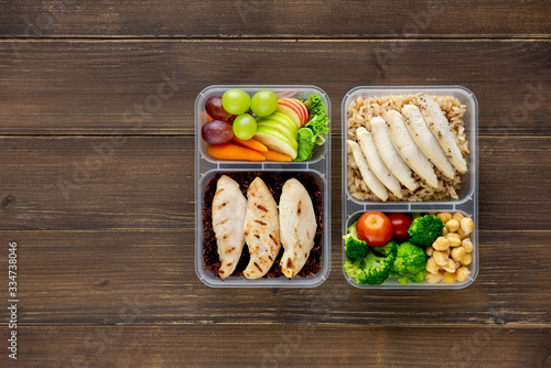Obraz na plátně Nutrient rich healthy low fat food in takeaway meal box sets on wood background
