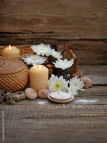 Spa composition with sea crystal salt, flowers and candles. relax concept. copy space.