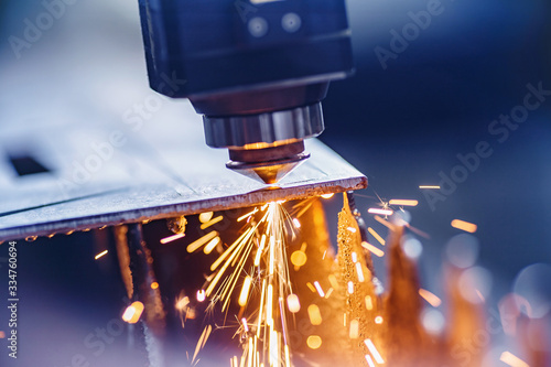 Fotografering CNC laser machine cutting sheet metal with light spark