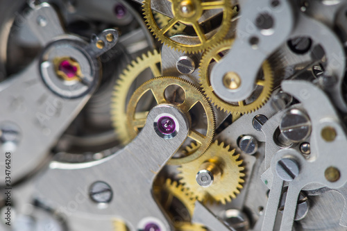 Fototapeta Macro close-up of complex watch movement parts. Focus on the ruby jewel. obraz