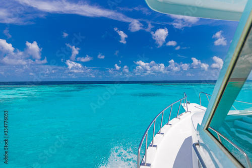 Beautiful view from front of yacht at seaward. Luxury lifestyle. Tropical sea transport, recreational boat vacation or snorkeling trip in Maldives or French Polynesia or Caribbean
