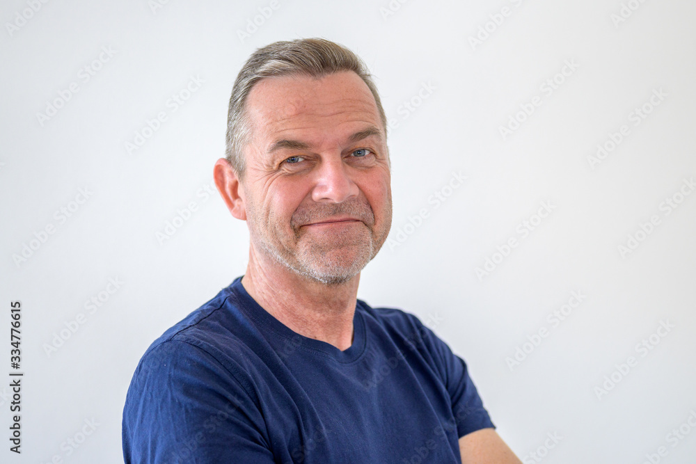Fototapeta Smiling friendly attractive middle-aged man