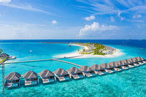 Perfect aerial landscape, luxury tropical resort or hotel with water villas and beautiful beach scenery Canvas Print