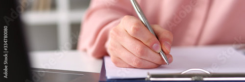 Fototapeta Closeup, female hands taking notes with pen office obraz