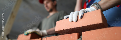 Fotografie, Obraz Builders make wall brick and cement, technology