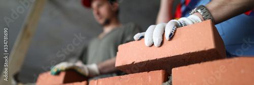 Fototapeta Builders make wall brick and cement, technology obraz