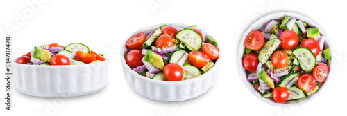 Fototapeta Cucumber tomato avocado red onion salad on a white isolated background obraz