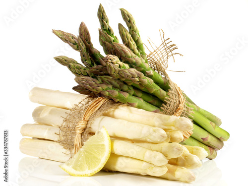 Green and White Asparagus Bundles with Lemon on white Background Canvas Print