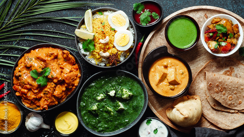 Fotografie, Tablou Indian cuisine dishes: tikka masala, paneer, samosa, chapati, chutney, spices