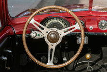 Classic 1951 Simca 8 Sport Convertible Car Looking At Dashboard And Steering Wheel From The Drivers Seat And Top Down.
