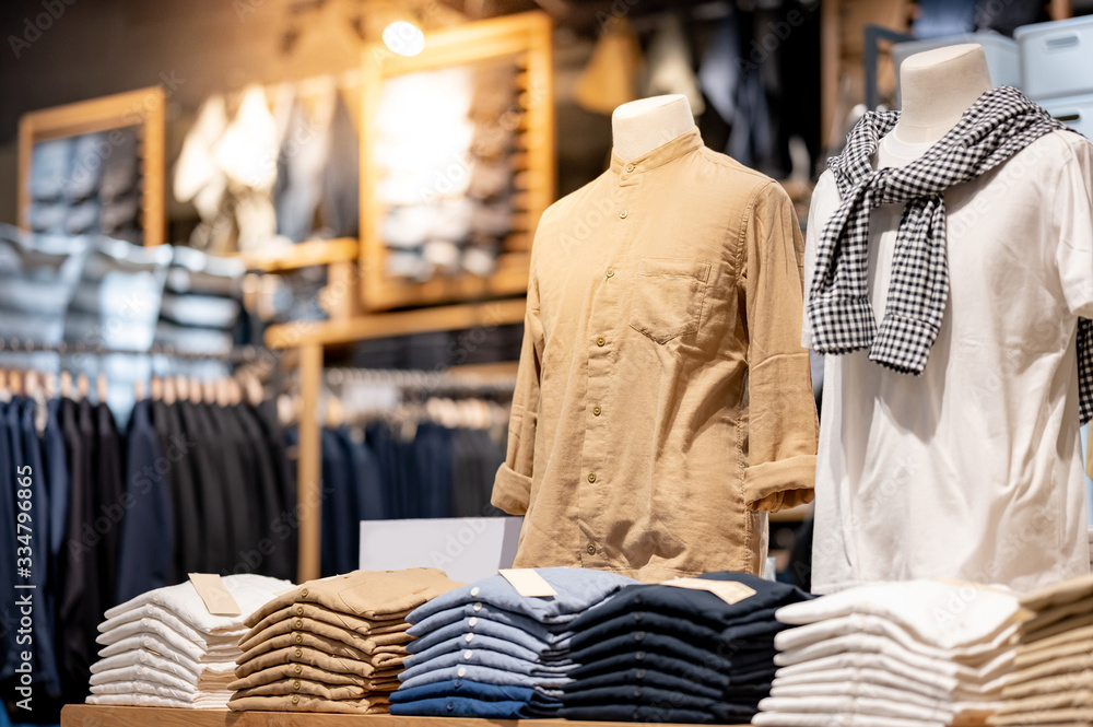 Fototapeta Trendy cotton Men shirt display on mannequin in clothes shop. Summer collection fashion product samples in clothing store for selling. Textile industry and business concept