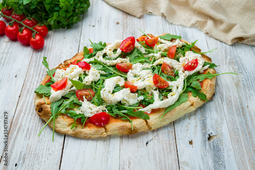 Pinsa with tomatoes, aragula and stracciatella. rome pizza Wallpaper Mural