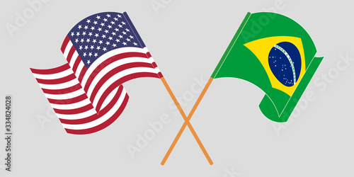 Fototapeta Crossed and waving flags of Brazil and the USA