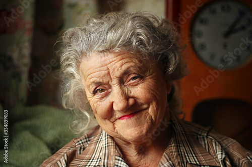 Looking and smile elderly woman portrait on a dark background Poster Mural XXL