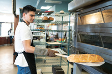 Hispanic Male Baker With Loaf ...