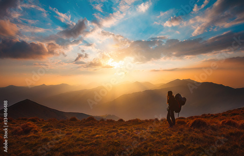 Fototapeta Hiking trough epic mountain landscape with a big backpack, exploring and feeling the freedom of nature obraz
