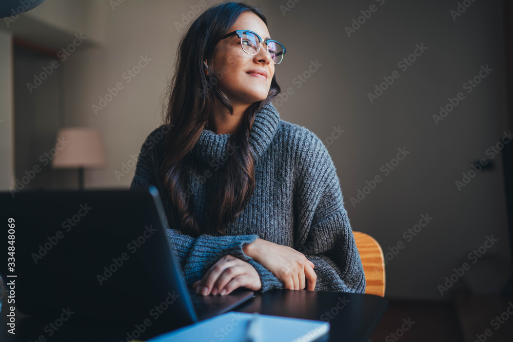 Fototapeta Happy attractive young woman working in modern office using laptop, businesswoman in casual wear working from home office on new product development strategy