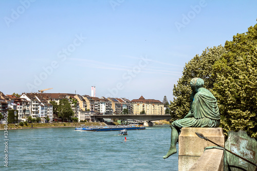 Basel, SWITZERLAND: Sitting Helvetia statue on the river Rhine in Basel, Switzer Fototapet