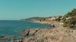 Spain Costa Brava Mediterranean coastline panning from the sea shore, Canyelles Grosses, Roses, Catalonia