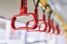 Interior Elements Of Public Transport - City Bus Grab Handles - On A Blurred Background