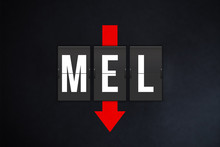 Melbourne Tullamarine International Airport IATA Code (MEL). Split-flap Airport Terminal Alphabet And Down Red Arrow On Black Background. Air Traffic And Aviation Industry Fall Concept..