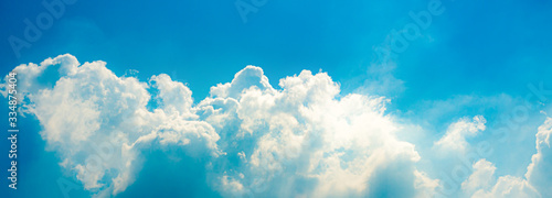 Obraz Bright sky and clouds. heavenly. warm look. Panorama view. cloudscape - fototapety do salonu