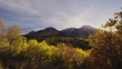 Autumn scene with mountain peaks, yellow aspen forests and fall colors at sunset