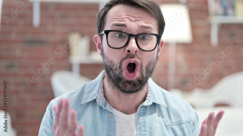 Portrait of Beard Young Man Shouting in Anger Wallpaper Mural