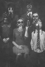 Social Distancing Family Photo With Everyone Wearing Gas Masks