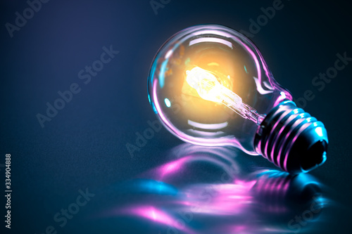 Obraz abstract light bulb with a glow - fototapety do salonu