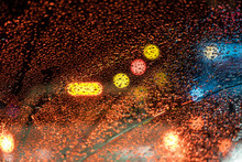 Raindrop Background, Bokeh Orange Lights In Celebration As Abstract Background.
