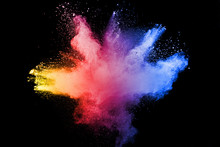 Abstract Multicolored Powder Explosion On Black Background