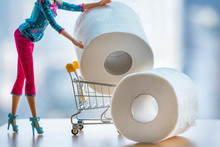 Doll Manufactured Woman Pushing Trolley Shop Cart Filled With Jumbo Great Toilet Paper On Light Background. Girl Fashion Purchase Panic Shopping Coronavirus Crisis Stockpile Products Concept