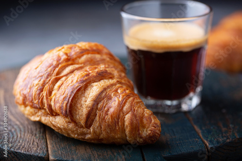 Airy and light croissant with espresso for breakfast Canvas Print