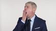 Senior Businessman Yawning and Stretching Body on White Background