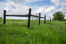 H-brace On A Barbed Wire Fence In Springtime