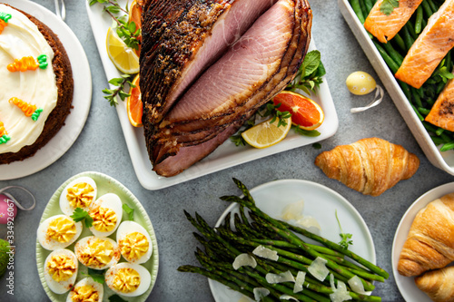 Big traditional Easter brunch with ham, quiche lorraine and carrot cake Canvas Print