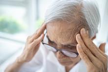 Sick Senior Woman With Headach...
