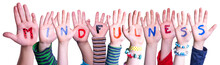 Children Hands Building Colorful English Word Mindfulness. White Isolated Background